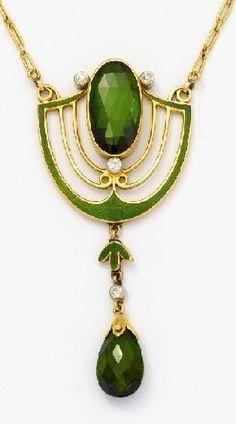"Jugendstil. Pendant necklace with tourmaline Email stocking Gold, silver, green enamel. 9.8 g. 1 oval faceted tourmaline D.ca. 15.55 x 8,40mm, 1 tourmaline drops D.ca. 10.45 x 7,60mm, 4 old cut diamonds, L. 39,0cm. ~ To 1900's. Result € 2,375 324. Auction ""Decorative Arts"", Lot 19, 23/10/2013 VAN HAM"