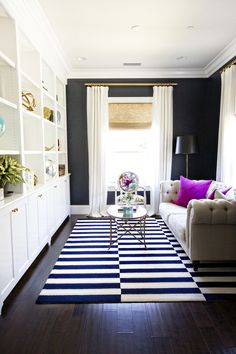 Go dark to make a room feel larger: http://www.stylemepretty.com/living/2014/11/04/15-great-to-know-decorating-secrets/