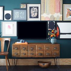 "With the dark blue wall, the TV almost disappears.  Librarian Media Console | west elm  53""w x 18""d x 28""h. Reclaimed pine solid wood frame. Metal hairpin legs."