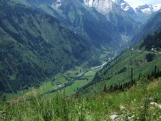 Hinterglemm, Austria. Mountain view of valley with river running through it.