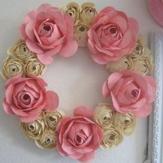 http://www.etsy.com/listing/156148677/light-pink-paper-flower-wreath-for-door