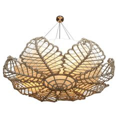 Iron and rattan chandelier with a leaf-inspired overlay.   Product: ChandelierConstruction Material: Iron and r...