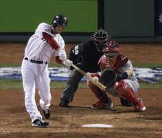 Boston Red Sox's Stephen Drew hits a home run during the fourth  inning of Game 6 of baseball's World Series against the St. Louis Cardinals...
