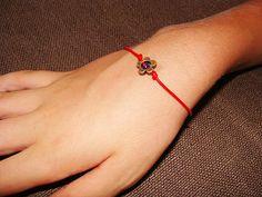 bracelet from Israel. red thread. evil eye.