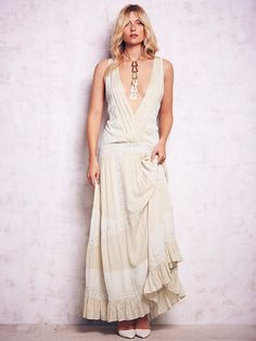 Free People Oberoi Dress, $250.00 Comes in a really pretty purple too….  Might be the one!