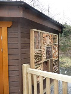 Built onto the side of this octagonal timber laboratory is this habitat box filled with materials from the site.