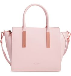 This statement making pale pink satchel with signature rose gold accents is a must-have accessory.