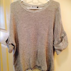 Large cable knit grey pullover sweater This pullover has 3/4 length sleeves with rolled cuffs for a cozy loose fit. Pol Sweaters