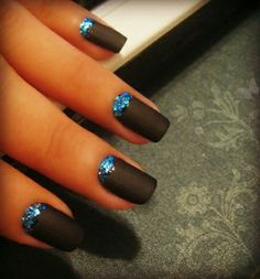Cuticle glitter nail art design in blue glitters with black matte nail polish.