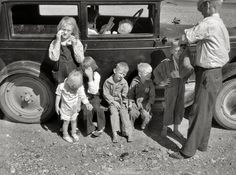 "Oh..how hard it must've been for them all. Dad is giving son a drink and Mom is studying a map. Note the boy's arm in a sling and oh, all those teensy little shoes & feet. God bless them. I hope it all turned out great for them. July 1936. ""Drought refugees from Bowman, North Dakota, in Montana."" En route to Oregon or Washington."