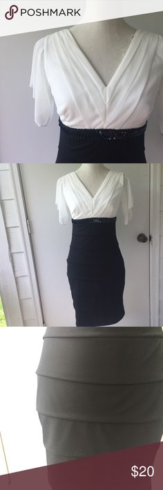 Black and White Bandage Semi-Formal Dress Super gorgeous black and white tiered dress. The top is pleated down to a v neck and has cute flutter sleeves. The bottom is a tiered black body con bandage skirt. Perfect for a business function or a brunch!   same day shipping on orders before 6 pmnext day shipping on all others10% bundle discount(and others, see bundle listing at top of closet)make me an offer! Enfocus Studio Dresses Midi