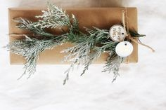 Adorn your Holiday gifts with a small string of cedar garland   Easy DIY Instructions for adding greenery to gifts