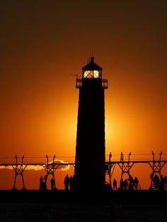 Grand Haven Lighthouse, MI.   Sunset in Silhouette