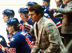 Herb Brooks watching from behind the bench as Wells, Verchota and Suter observe as well...
