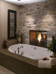 Install a two-sided fireplace between the bathroom and the bedroom. Who needs heated tiles when you have a bathroom fireplace? Dream Bathrooms, Beautiful Bathrooms, Master Bathrooms, Luxury Bathrooms, Master Baths, Romantic Bathrooms, Cosy Bedroom Warm, Romantic Master Bedroom Ideas, Fancy Bathrooms
