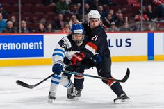 Sebastian Aho Photos Photos - Dylan Larkin #21 of Team United States holds back Sebastian Aho #26 of Team Finland during the 2015 IIHF World Junior Hockey Championship game at the Bell Centre on December 26, 2014 in Montreal, Quebec, Canada. - United States v Finland - 2015 IIHF World Junior Championship