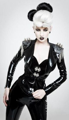 Very sexy latex outfit. Spikes.