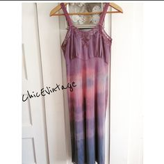 "BOHEMIAN Hand Dyed Vintage Slip Dress I hand select each slip according to style, length & feminine detail. Each receives a unique dye bath, some receive multiple baths to obtain varied pigmented colors. This process seals the nylon fibers & allows for deeper color in some spots. This is done purposefully to create a piece of wearable art. Because my slips vary in vintage ware no two are alike and are sold as is. Blue pink lavender. Bust 30-32"" waist 26-28 hips 32-36"" length 36 (underarm to…"