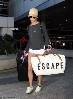 Battle wounds? Nina Dobrev showed off bruises up and down her legs as she returned to Los Angeles in short white shorts and a grey sweatshirt