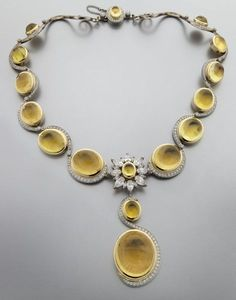 A 18K, yellow beryl and diamond necklace. PreSale Estimate: 20,000.00 – 30,000.00 being auctioned by Dallas Auction Gallery