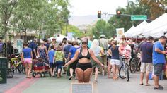 Amy Pence-Brown stands blindfolded, wearing nothing but a bikini in a busy market in Boise, Idaho, to promote self-love and body positivity.
