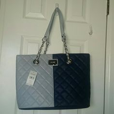 Nine west blue city block bag Brand new with tags. Blue quilted design, silver hardware, logo plate and partial chain straps. Navy and light blue-gray color block purse. Super cute bag for all seasons. Nine West Bags Shoulder Bags