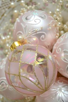 Pink Christmas decorating - so pretty and feminine.  Lace, pearls, crystal, ribbons and flowers.  Check out this blog:  Pink Christmas - Jennelise