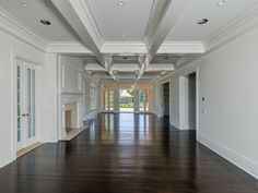 dream home, coiffered ceiling, dark hardwood floors, fireplace, hamptons home - Jeffery Collé's First New Residence In Two Years - Gambrel Porn - Curbed Hamptons