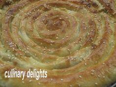 Bonjour La m'mhencha est un serpentin a base de feuille de briks , farcie aux amandes et plonge' ds du miel....un gateau qu'on consomme bcq pendant le ramadan, du mois en Algerie. Voici une recette moderne de mhencha salee' qu'on peut faire avec la pate...