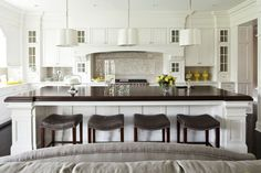 granite island. white kitchen.