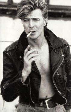 David Bowie photographed by Herb Ritts in LA, even with a cigarette still The Ma. - David Bowie photographed by Herb Ritts in LA, even with a cigarette still The Man Who Fell To Earth - David Bowie, The Thin White Duke, Black And White, Black Star, Duncan Jones, Herb Ritts, Rock Poster, We Will Rock You, Ziggy Stardust