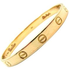 1970's Cartier Love Bracelet By Aldo Cipullo In Yellow Gold Size 16 found on Polyvore