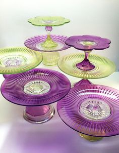 Hand Painted Cake or Cupcake Stands - Dollar Tree dishes and candle sticks painted with glass paint on the underneath side.