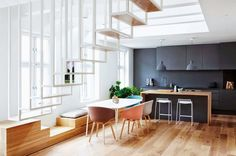 Black Kitchen With Colorful Chairs