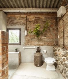 clara nubiola converts a deteriorating shed into the cube changing room Brick Bathroom, Bathroom Interior, Outdoor Bathrooms, Rustic Bathrooms, Small Buildings, Changing Room, Brick And Stone, Stone Houses, Exposed Brick