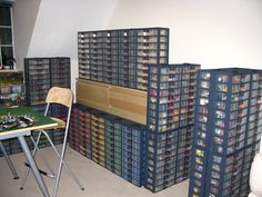 """It looks like each drawer in this storage system has dividers within it, similar to the ubiquitous """"Plano"""" boxes (which have a tight fitting lid.)"""