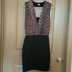 Venus dress Leopard top, Venus dress. Never worn except try on. Stored in a non smoker, non pet having home. Size 6 but fits bigger. Venus Dresses Mini