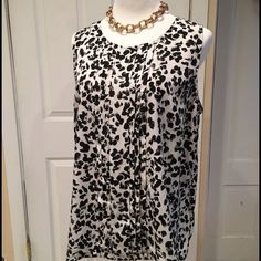 Black & White Top  Black and white sleeveless blouse. 100% polyester. Pleated design down the front and button closure at the back of neck. Perfect under a blazer!  Merona Tops Blouses