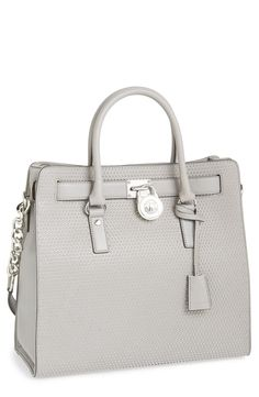 The Michael Kors Hamilton Microstud tote is a season must-have.