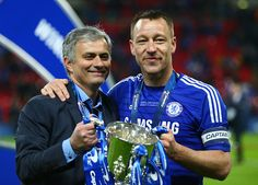 Manager Jose Mourinho of Chelsea and John Terry of Chelsea pose with the trophy during the Capital One Cup Final match between Chelsea and Tottenham Hotspur at Wembley Stadium on March 1, 2015 in London, England