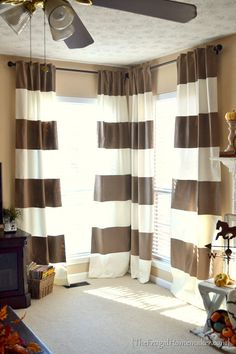 DIY painted striped curtains.  Totally going to do this for the family room.  May use a shower curtain.