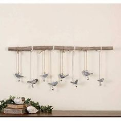 Home-Decor-Home-Accessories-Photo-Frames-Uttermost-13885  SmallMetal BirdsFinished In A Dark Bronze With A Light Ivory Glaze Suspended From ANatural Elm BranchWithIvory RibbonAnd Natural Rope. Each Bird Has AClip At Feet For Hanging Pictures Or Notes. Size And Shape Of Branch Will Vary.