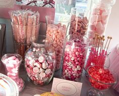 Put together a candy buffet for Fallon's shower w/ all pink and brown, and made little white treat bags that were stamped w/ pink and brown baby items (and a thank you tag attached). The Christmas Tree shop is a great place for glass jars.