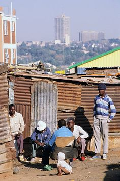Poor black South Africans sit among shacks in Alexandra Township, with a view of the wealthy white suburb of Sandton City, in Johannesburg, South Africa. Get premium, high resolution news photos at Getty Images Village Photography, Landscape Photography, Travel Photography, African Jokes, African Art, Johannesburg Skyline, David Goldblatt, Somewhere In Time, Apartheid