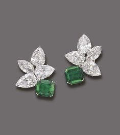 AN EXQUISITE PAIR OF EMERALD AND DIAMOND EAR CLIPS, BY HARRY WINSTON Each clip designed as a rectangular-cut emerald weighing 5.86 and 4.54 carats with pear and marquise-shaped diamond cluster, total weight of diamonds 24.61 carats, mounted in platinum, in black suede Harry Winston case With maker's mark for Harry Winston