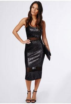 We are crushing on this chic black sequin midi dress this season. With dainty white sequin disc covering and fierce mesh panel detail to the waist and hem this dress is every party girls dream. Team this with white strappy heels and metalli...