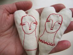 stitched faces.