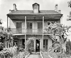"""New Orleans circa 1937. """"837 Gov. Nicholls Street."""" We just dropped by to say hi. 8x10 inch acetate negative by Frances Benjamin Johnston"""