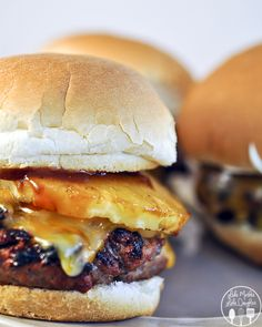 Teriyaki cheeseburgers - These burgers are juicy and sweet. Built with teriyaki sauce, grilled pineapple and onions, and a slathering of mayonnaise.