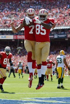 21672cf92 Vernon Davis (85) and Colin Kaepernick (7) of the San Francisco 49ers